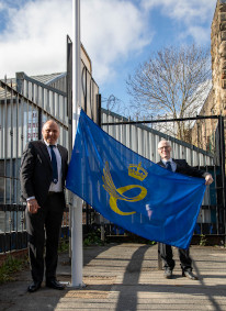 Mike Riding and Jonathan Cook from Pi raising the Queen's Award for Enterprise flag